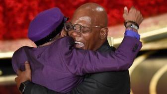 "Samuel L. Jackson, right, embraces Spike Lee, winner of the award for best adapted screenplay for ""BlacKkKlansman"" at the Oscars on Sunday, Feb. 24, 2019, at the Dolby Theatre in Los Angeles. (Photo by Chris Pizzello/Invision/AP)"