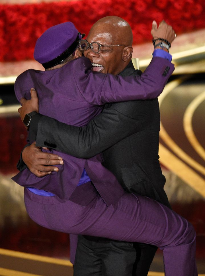 Spike Lee jumps on friend and Oscars presenter Samuel L. Jackson after receiving his first Oscar win on Sunday, February 24,