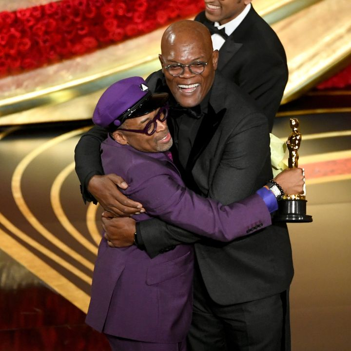 Spike Lee accepts the Best Adapted Screenplay award for 'BlacKkKlansman' from Samuel L. Jackson onstage during the 91st Annua