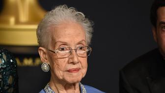 "FILE - In this Feb. 26, 2017, file photo, Katherine Johnson, the inspiration for the film, ""Hidden Figures,"" poses in the press room at the Oscars at the Dolby Theatre in Los Angeles. Johnson, the NASA mathematician whose calculations helped bring Apollo astronauts back to Earth, is being honored at her alma mater with a bronze statue and a scholarship in her time. West Virginia State University says a dedication ceremony is planned for Aug. 25, 2018, the day before Johnson's 100th birthday. (Photo by Jordan Strauss/Invision/AP, File)"