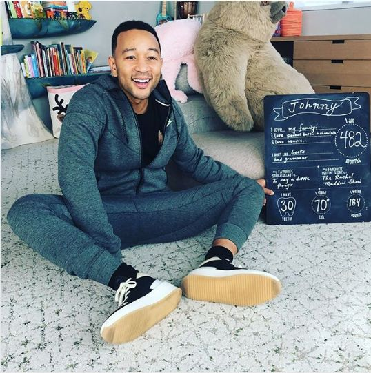 Chrissy Teigen mimicked baby milestone pics with a hilarious photo of John Legend.