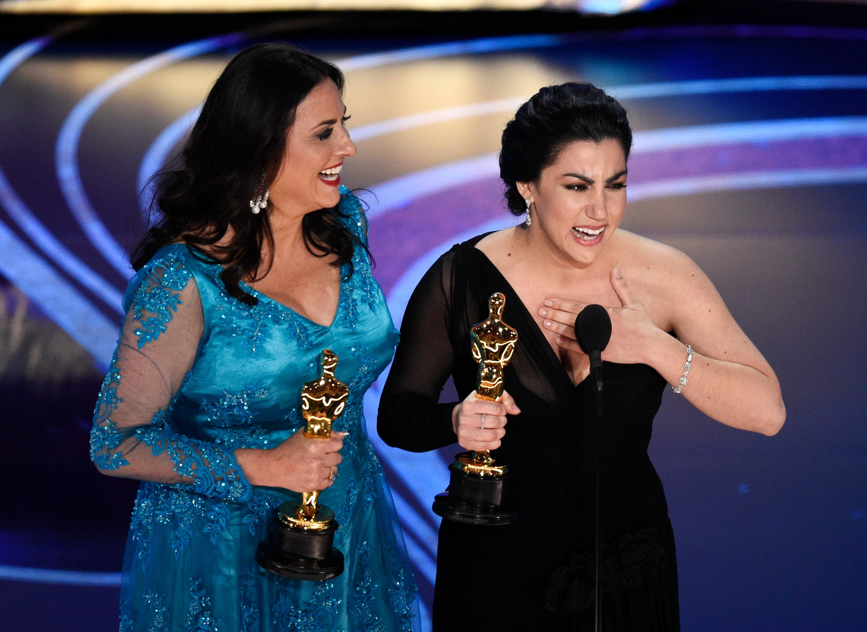 "Melissa Berton, left, and Rayka Zehtabchi accept the award for best documentary short subject for ""Period. End of Sentence."" at the Oscars on Sunday, Feb. 24, 2019, at the Dolby Theatre in Los Angeles. (Photo by Chris Pizzello/Invision/AP)"
