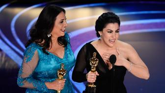 """Melissa Berton, left, and Rayka Zehtabchi accept the award for best documentary short subject for """"Period. End of Sentence."""" at the Oscars on Sunday, Feb. 24, 2019, at the Dolby Theatre in Los Angeles. (Photo by Chris Pizzello/Invision/AP)"""