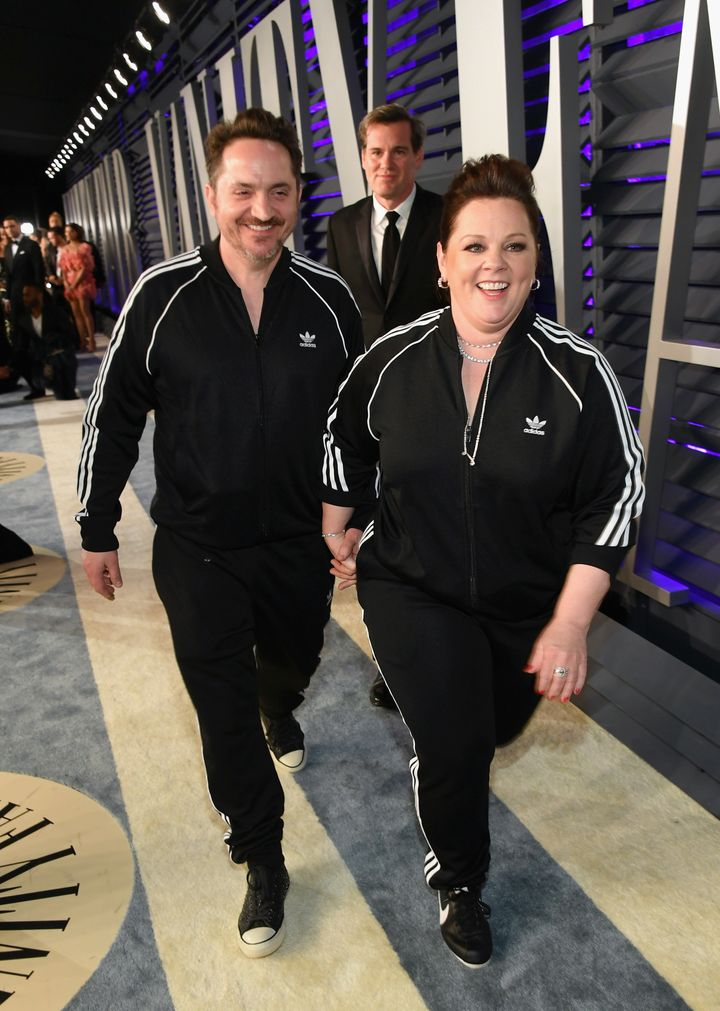 Melissa McCarthy and Ben Falcone walk into the Vanity Fair Oscars party on Sunday.