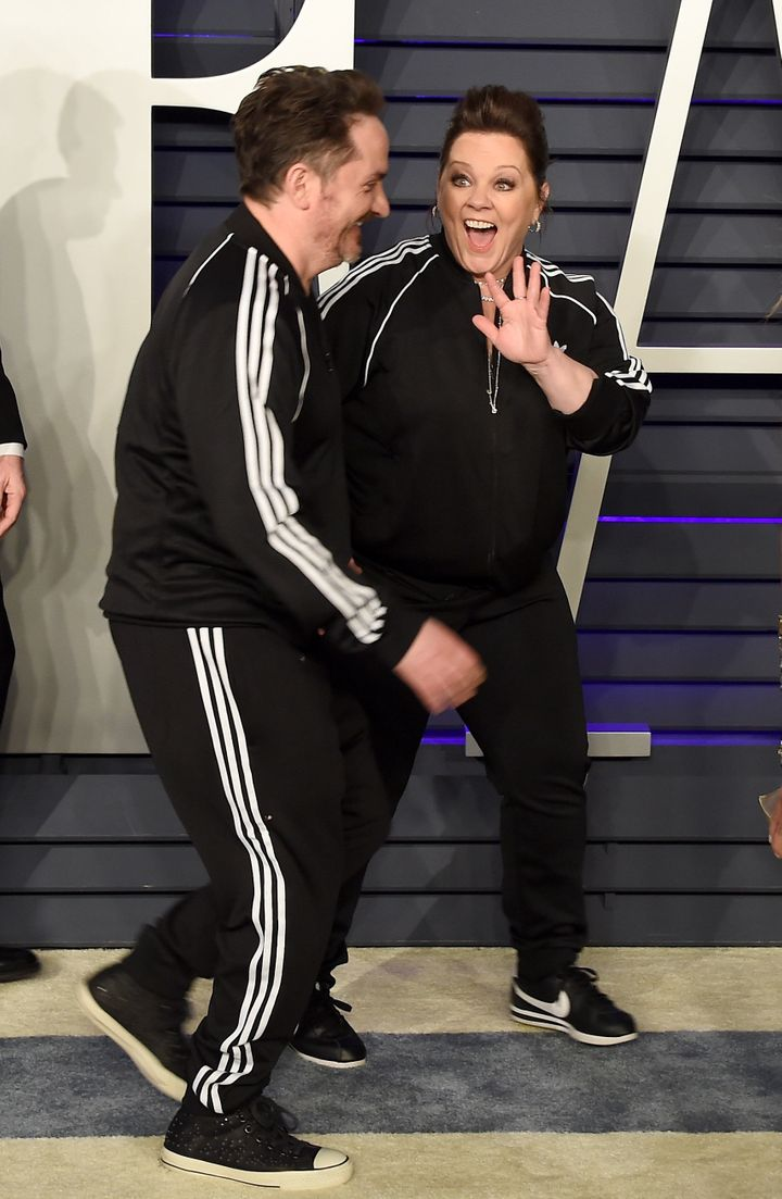 The two wore Converse and Nike sneakers (gasp!) with their Adidas tracksuits, which is sure to send any sneakerhead into a ta
