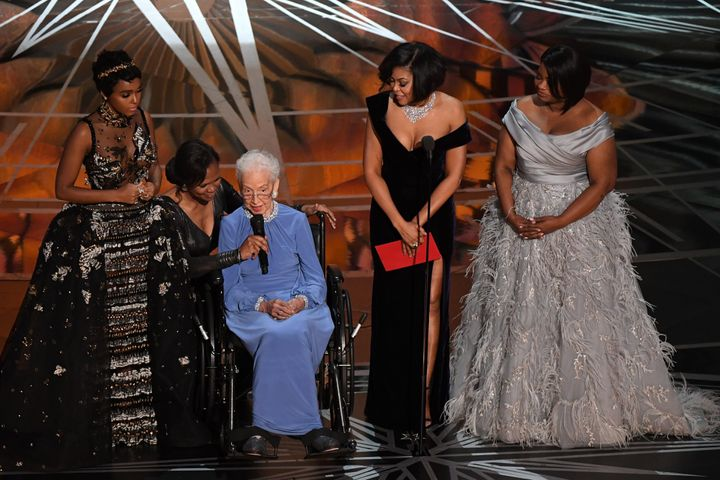 NASA mathematician Katherine Johnson (center) is accompanied by actresses Janelle Monae (left), Taraji P. Henson (second from
