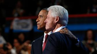 CHARLOTTE, NC - SEPTEMBER 5:President Barack Obama and Former president Bill Clinton after Clinton's speech during the 2012 Democratic National Convention at the Time Warner Center on September 5, 2012 in Charlotte, North Carolina. (Photo by Lucian Perkins for The Washington Post via Getty Images)
