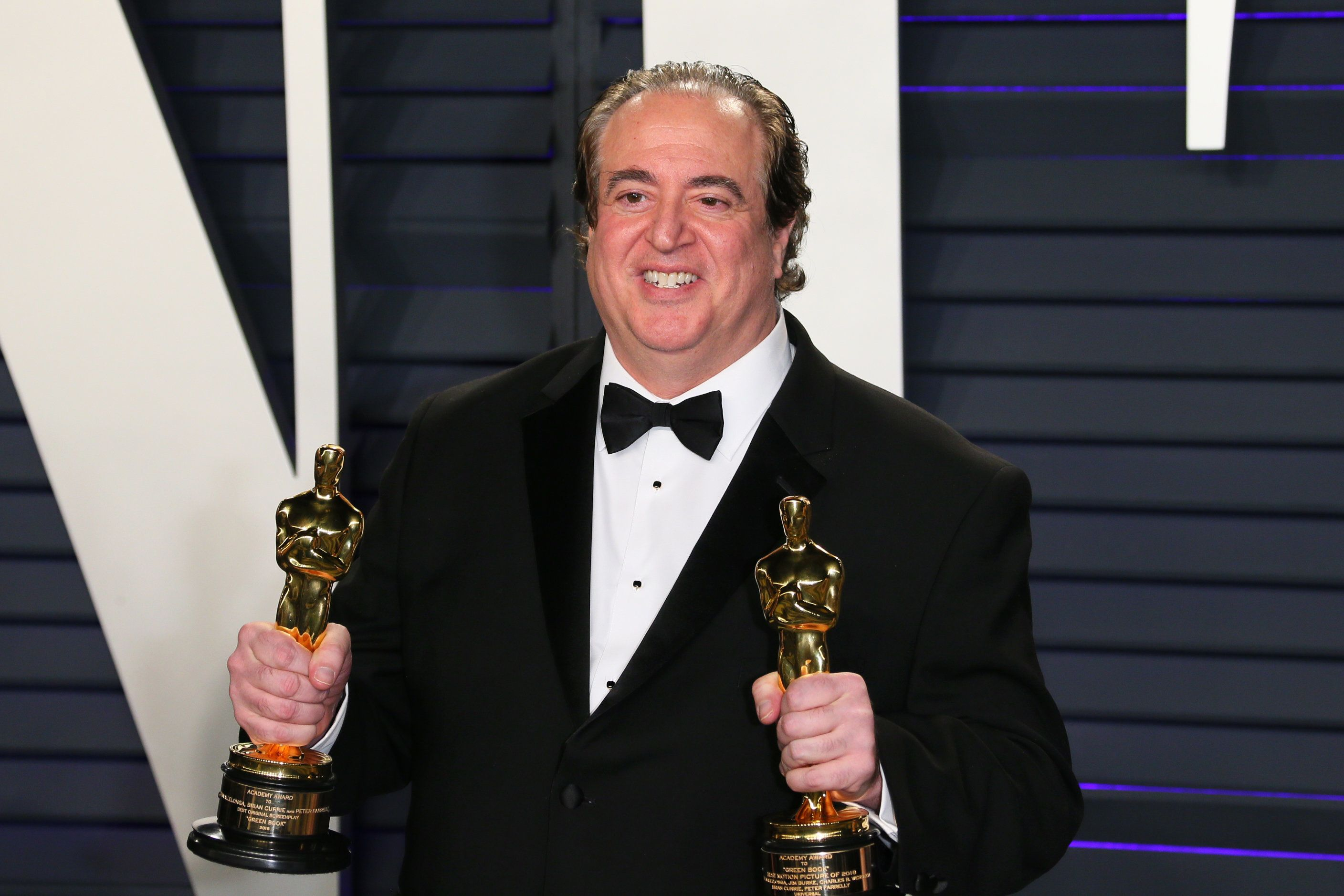 "Nick Vallelonga poses with the Oscars for Best Picture and Best Original Screenplay for ""Green Book"" at the 2019"