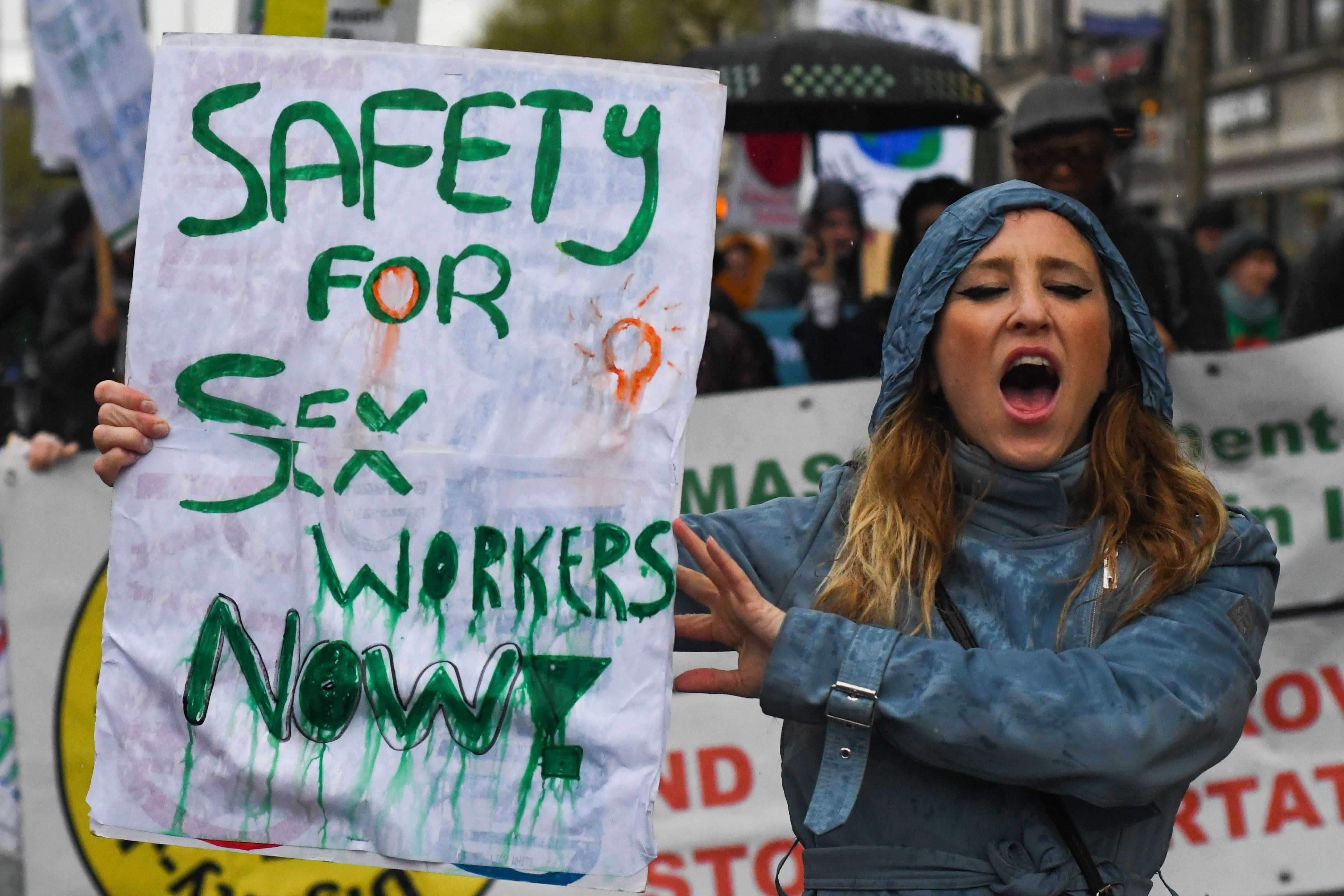 A young woman holds 'Safety for Sex Workers Now!' sign during an annual May Day march for workers' rights. On Tuesday, May 1, 2018, in Dublin, Ireland. (Photo by Artur Widak/NurPhoto via Getty Images)