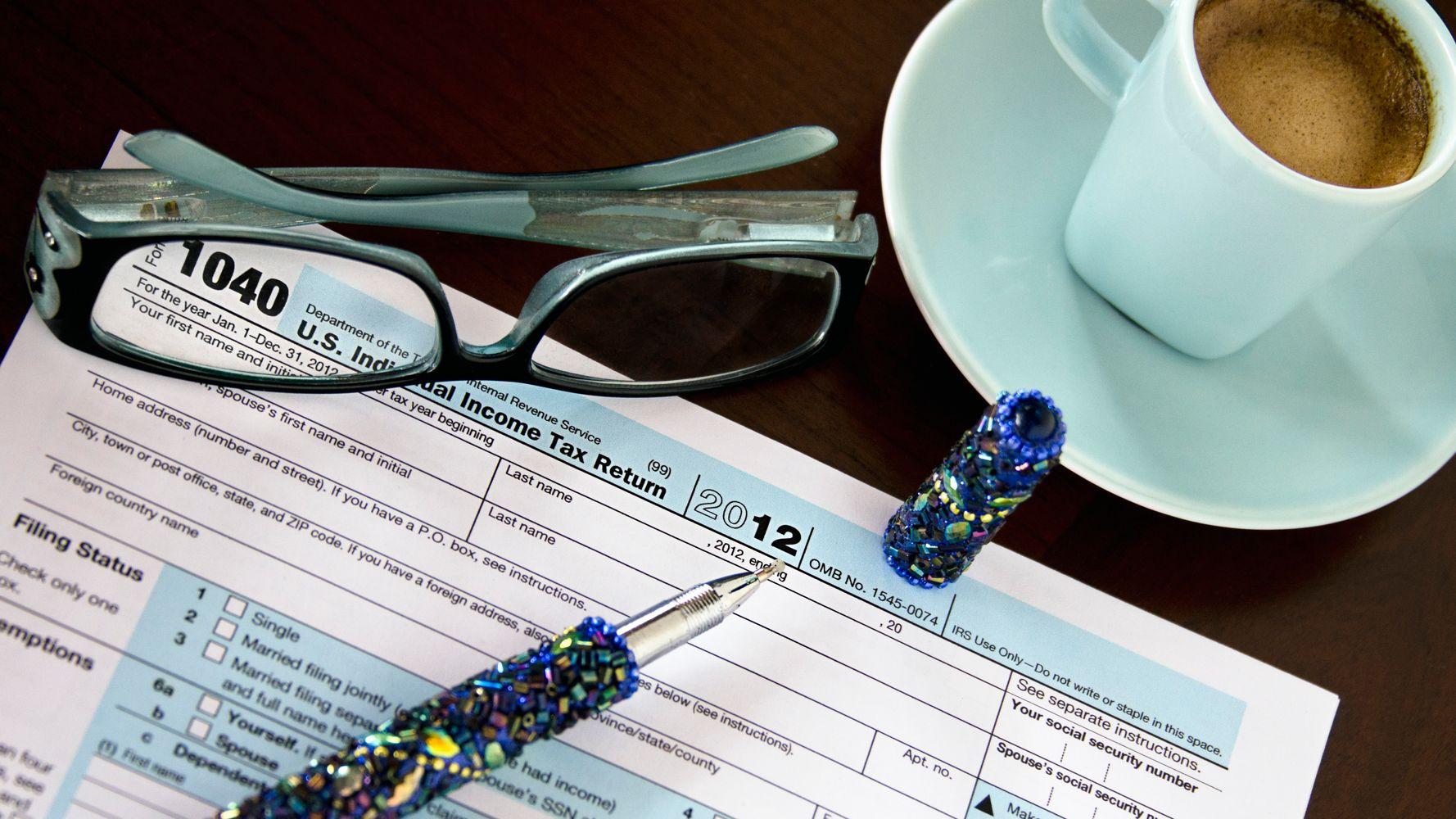 Should You Do Your Own Taxes Or Hire A Pro? Here's How To