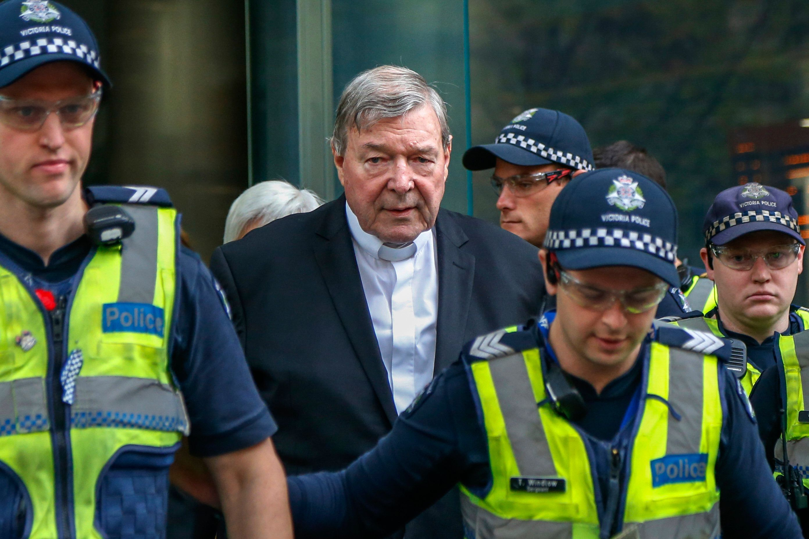 Cardinal George Pell, the most senior Catholic cleric to face sex charges, leaves court in Melbourne, Australia, Wednesday, May 2, 2018. Pell, the most senior Vatican official to be charged in the Catholic Church sex abuse crisis, arrived Wednesday for an appearance in the Melbourne court where he will eventually stand trial on sexual abuse charges spanning decades. (AP Photo/Asanka Brendon Ratnayake)