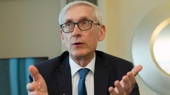 FILE - In this Feb. 23, 2019 file photo, Wisconsin Gov. Tony Evers speaks during an interview during the National Governors Association 2019 winter meeting in Washington. Evers wants to cap enrollment in Wisconsin's private voucher school program, ending expansions that Republicans have enacted over the past eight years. The proposal will be a part of Evers' two-year state budget that he releases on Thursday, Feb. 28. (AP Photo/Jose Luis Magana, File)