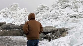 Mounds of ice collect along the Lake Erie shore at Hoover Beach, in Hamburg, N.Y., Monday, Feb. 25, 2019. High winds howled through much of the nation's eastern half for a second day Monday, cutting power to hundreds of thousands of homes and businesses, closing schools, and pushing dramatic mountains of ice onto the shores of Lake Erie. (AP Photo/Carolyn Thompson)
