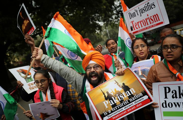 A National Akali Dal leader shouts slogans in support of India and against Pakistan as he celebrates reports of Indian aircra