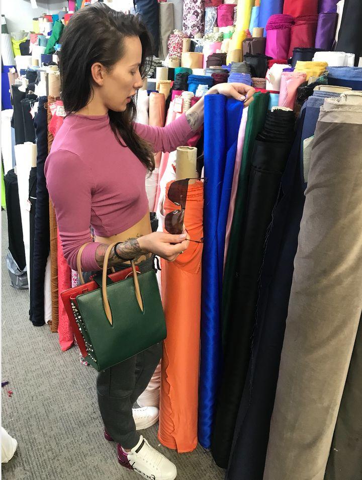 Carmen Liu choosing materials.