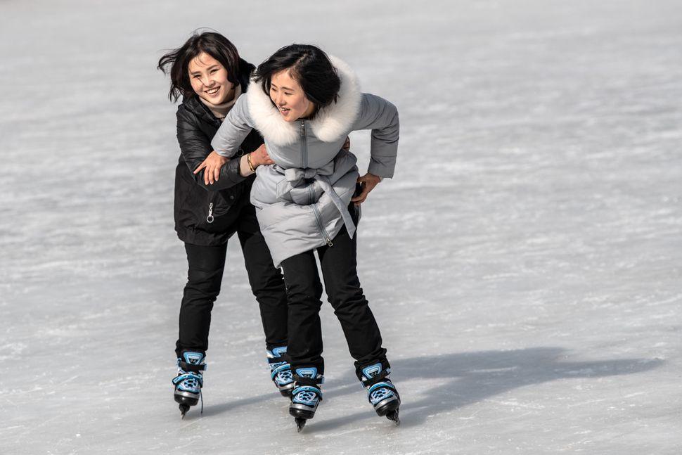 North Korean women skate at an ice rink at Masikryong Ski Resort on Feb. 5, near Wonsan, North Korea.