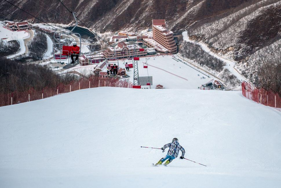 A visitor skis down a slope at Masikryong Ski Resort on Feb. 4, near Wonsan, North Korea.