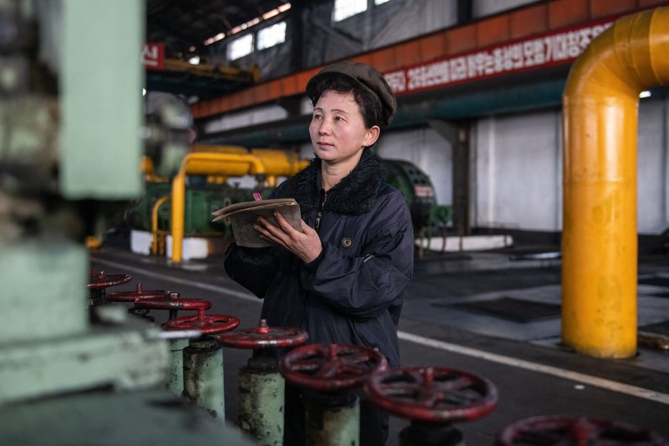 A worker takes notes of pressure readings on a machine in Hungnam Fertilizer Complex on Feb. 4 in Hamhung, North Korea.