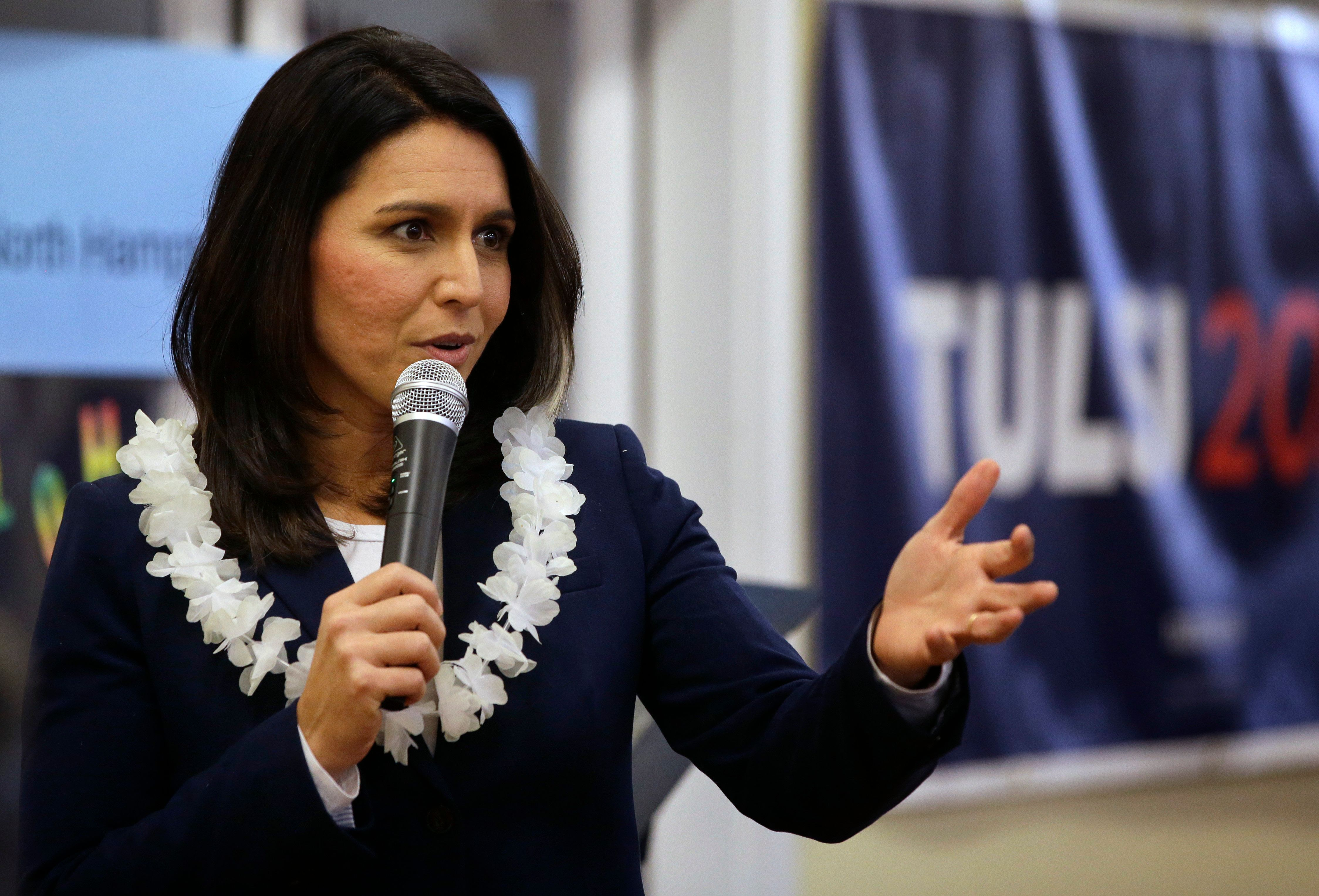 Presidential hopeful U.S. Rep. Tulsi Gabbard, D-Hawaii, addresses an audience during a meet and greet, Sunday, Feb. 17, 2019, in North Hampton, N.H. (AP Photo/Steven Senne)