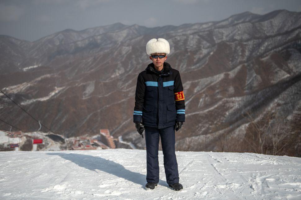 A resort worker poses for a photograph at Masikryong Ski Resort on Feb. 5, near Wonsan, North Korea.