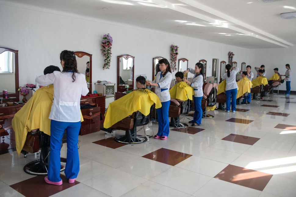 Workers have their hair cut in a salon at Hungnam Fertilizer Complex on Feb. 4, in Hamhung, North Korea.