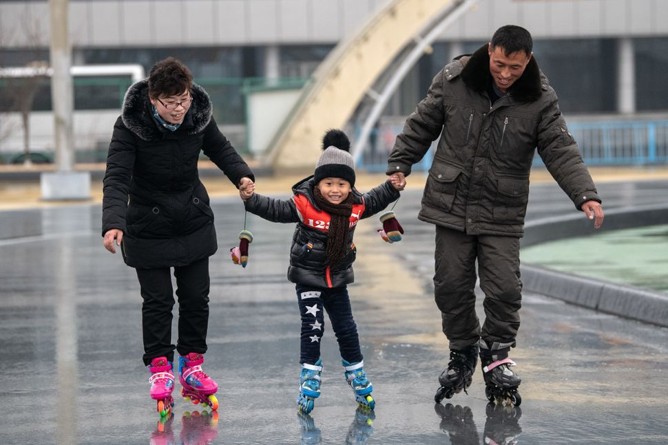 A North Korean child is taught how to roller skate at a skate park on Feb. 6 in Pyongyang.