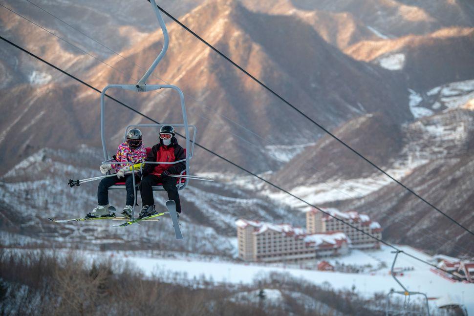 Skiers ride a lift at Masikryong Ski Resort on Feb. 4, near Wonsan, North Korea.