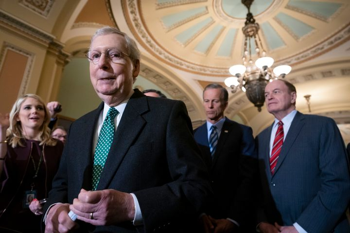 Senate Majority Leader Mitch McConnell (R-Ky.) speaks to reporters on Feb. 12 about the bipartisan compromise worked out to a