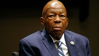 FILE - In this Oct. 30, 2017, file photo, Rep. Elijah Cummings, D-Md., participates in a panel discussion during a summit on the country's opioid epidemic at the Johns Hopkins Bloomberg School of Public Health in Baltimore. Cummings has been admitted to Johns Hopkins Hospital for a bacterial infection in his knee. His office said doctors drained the infection in a minor procedure Friday, Jan. 5, 2018. Cummings' office says he is resting comfortably and expects a full recovery. (AP Photo/Patrick Semansky, File)