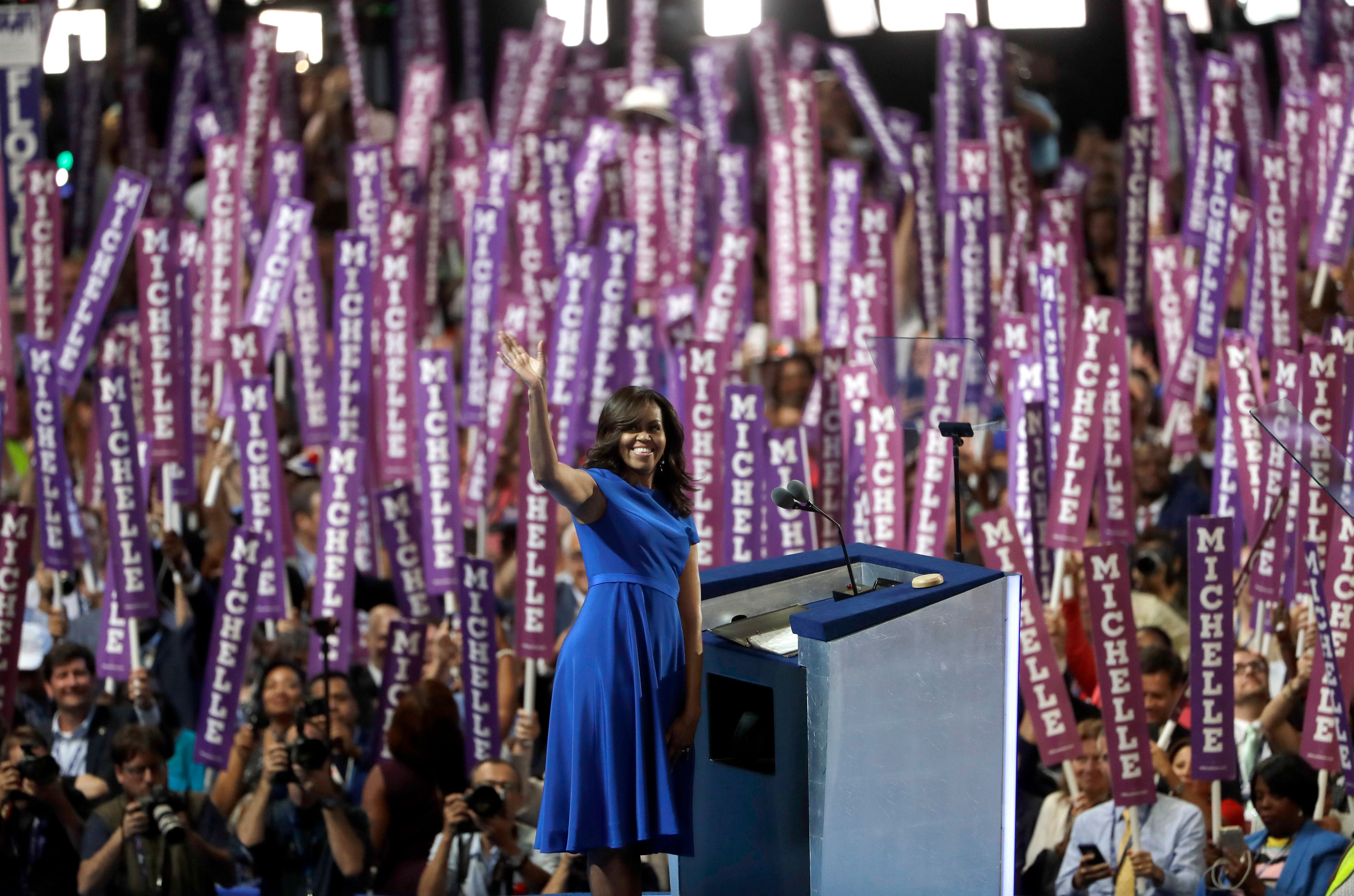 First Lady Michelle Obama waves as she speaks to delegates during the first day of the Democratic National Convention in Philadelphia , Monday, July 25, 2016. (AP Photo/Matt Rourke)