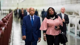 UNITED STATES - JANUARY 24: Rep. John Lewis, D-Ga., and Rep. Terri Sewell, D-Ala., walk through the Cannon tunnel to the Capitol after the House Ways and Means Committee organizational meeting for the 166th Congress on Thursday, Jan. 24, 2019. (Photo By Bill Clark/CQ Roll Call)