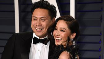 Jon M. Chu, left, and Constance Wu arrive at the Vanity Fair Oscar Party on Sunday, Feb. 24, 2019, in Beverly Hills, Calif. (Photo by Evan Agostini/Invision/AP)