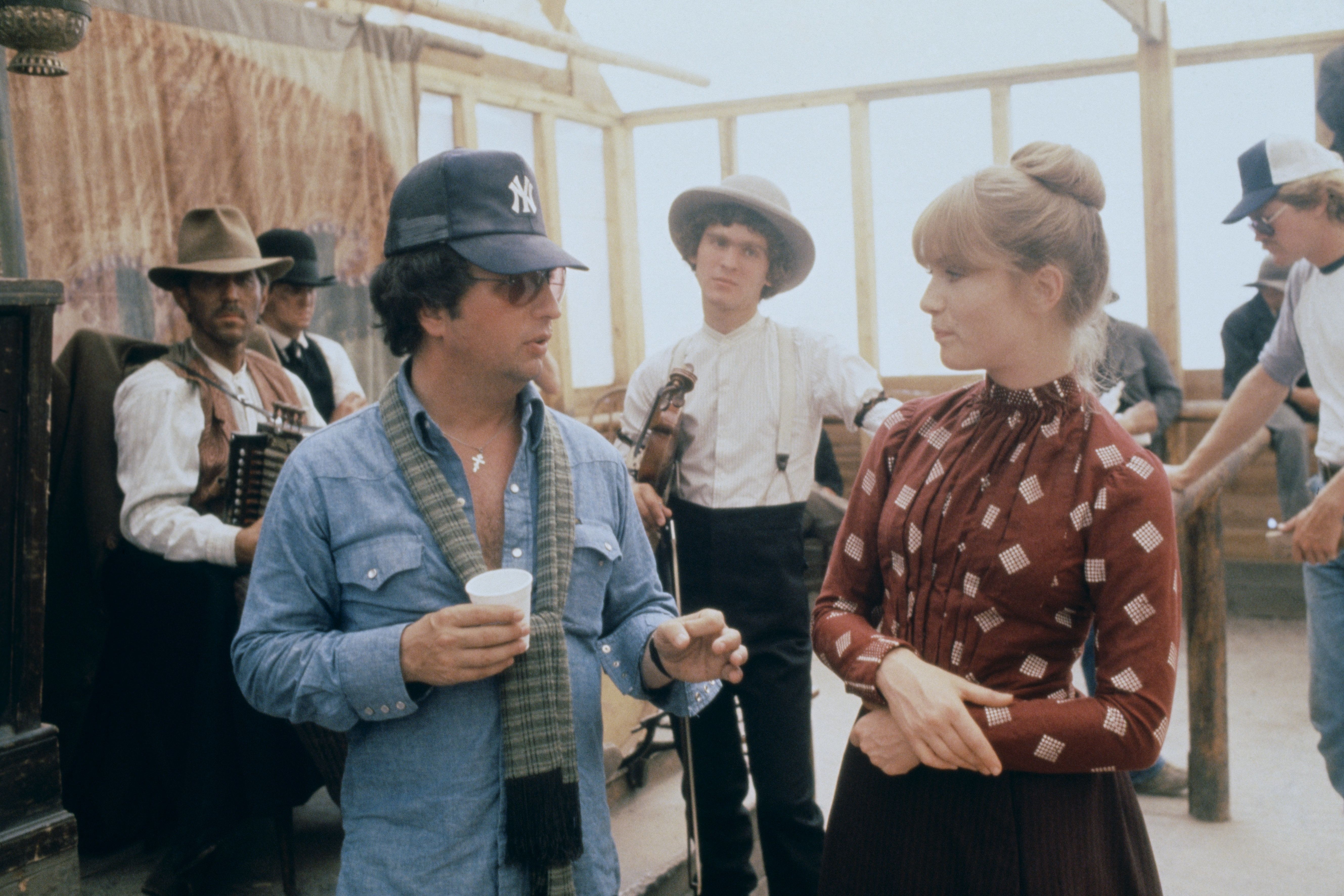 """Director Michael Cimino and Isabelle Huppert on the set of """"Heaven's Gate"""" in 1979."""