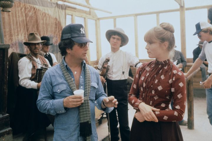 "Director Michael Cimino and Isabelle Huppert on the set of ""Heaven's Gate"" in 1979."
