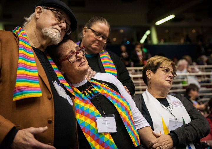 Ed Rowe, left, Rebecca Wilson, Robin Hager and Jill Zundel react to the defeat of a proposal that would allow LGBT clergy and