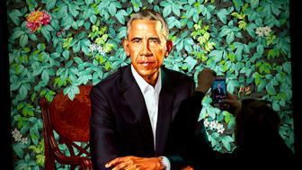 A visitors take picture of the official portrait of the former President Barack Obama in the first day open exhibit at the Smithsonian's National Portrait Gallery, Tuesday, Feb. 13, 2018, in Washington. Barack Obama's portrait was painted by artist Kehinde Wiley, and Michelle Obama's portrait was painted by artist Amy Sherald. (AP Photo/Jose Luis Magana)