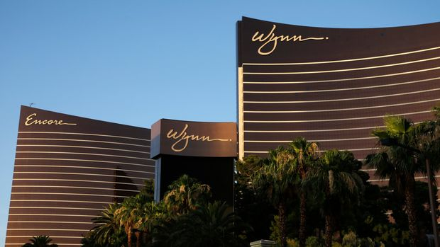 FILE - This June 17, 2014 file photo shows the Wynn Las Vegas and Encore resorts in Las Vegas, both owned and operated by Wynn Resorts. Nevada gambling regulators are due to sanction casino mogul Steve Wynn's former company for failing to investigate claims of sexual misconduct made against him before he resigned a year ago. A fine against Wynn Resorts Ltd. could amount to millions of dollars when the state Gaming Commission takes final action Tuesday, Feb. 26, 2019, to end a year-long investigation. (AP Photo/John Locher, File)