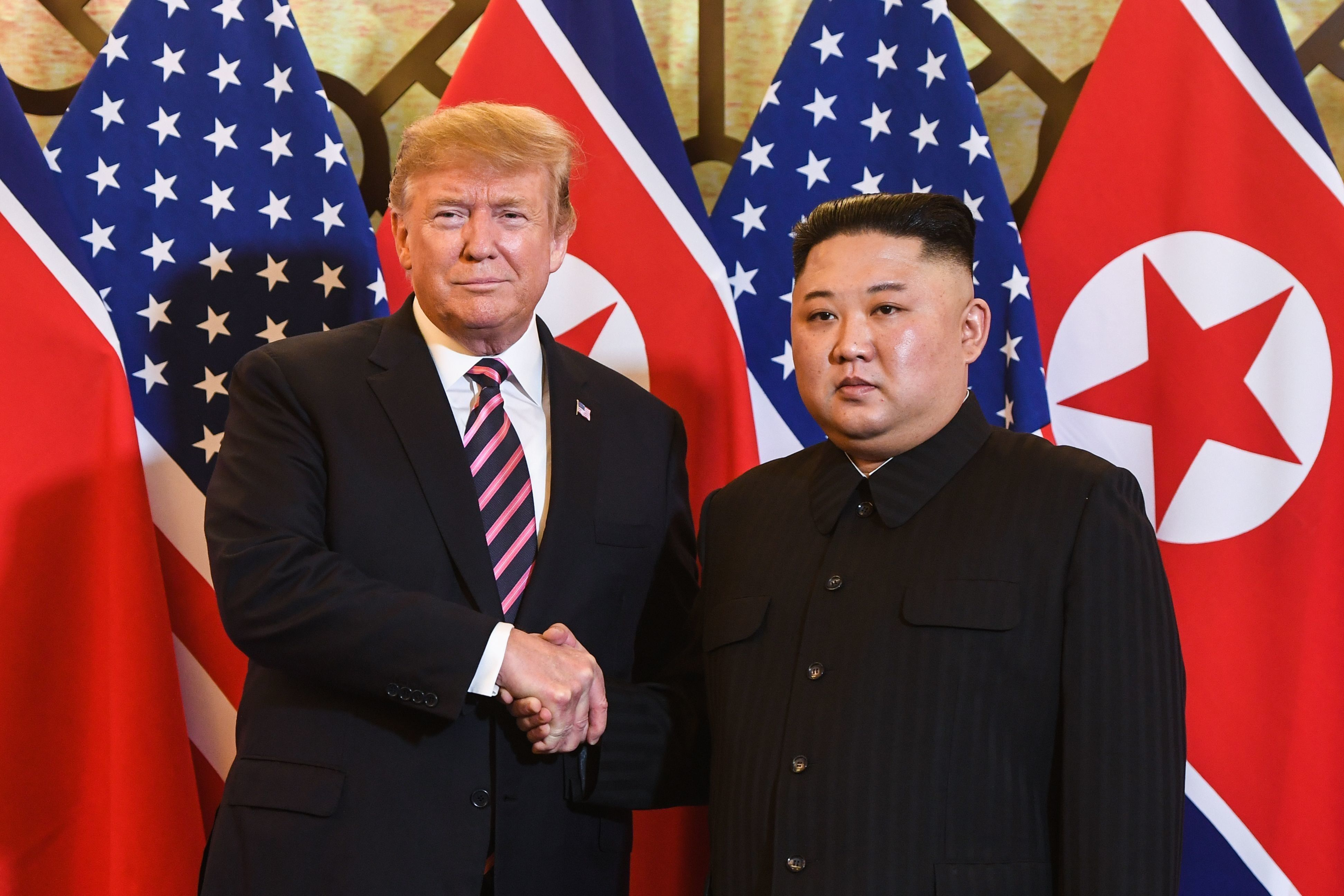 US President Donald Trump (L) shakes hands with North Korea's leader Kim Jong Un before a meeting at the Sofitel Legend Metropole hotel in Hanoi on February 27, 2019. (Photo by Saul LOEB / AFP)        (Photo credit should read SAUL LOEB/AFP/Getty Images)