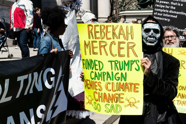 Protesters demand the American Museum of Natural History cut ties with Rebekah Mercer during a demonstration in 2015. Mercer