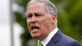 FILE - In this June 21,2018, file photo, Washington Gov. Jay Inslee speaks at a news conference in SeaTac, Wash. Inslee says the state plans to sue the Trump administration over its proposal to dismantle Obama-era pollution rules that would have increased federal regulation of emissions of coal-fired power plants. Inslee, a Democrat, told reporters Wednesday, Aug. 22, 2018, that the Environmental Protection Agency plan threatens lives and is also illegal. (AP Photo/Elaine Thompson, File)