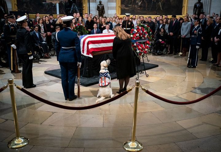 Sully sits near former President George H. W. Bush's casket as Bush lies in state at the U.S. Capitol in Washington, DC., in