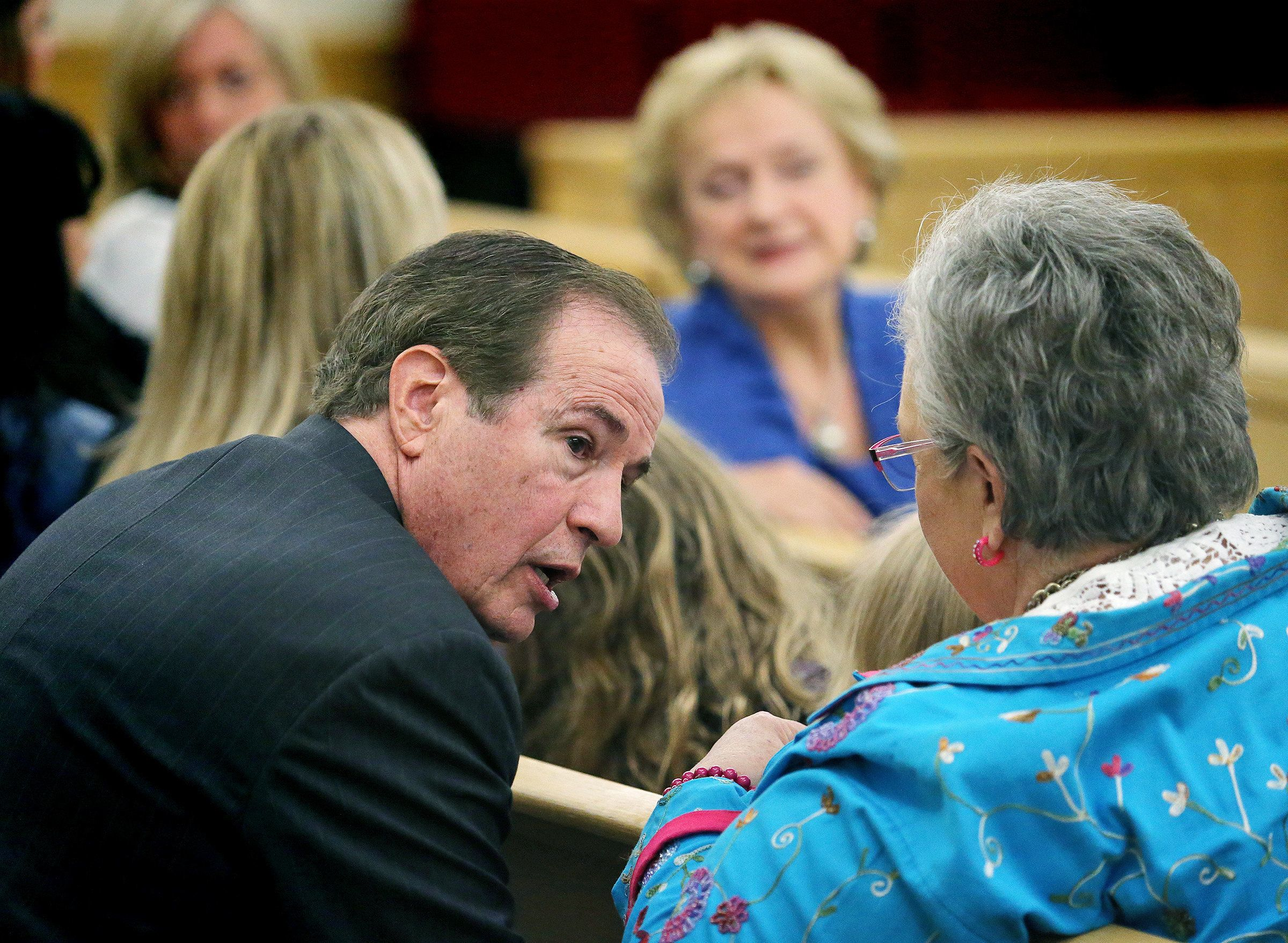 State Rep. Bill Zedler, left, Arlington- Dist 96, was in court to show support for Texas Attorney General Ken Paxton in Fort Worth, Thursday, Aug. 27, 2015. Paxton appeared for arraignment in State District Judge George Gallagher's court. He pleaded not guilty Thursday to charges alleging that he defrauded investors before he became the state's top lawyer, and his attorney Joe Kendall announced that he would no longer represent him. (Paul Moseley/Star-Telegram via AP, Pool)