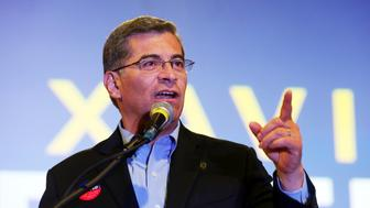 California Attorney General Xavier Becerra talks to supporters at a Democratic Party gathering at La Plaza de Cultura y Artes in the historic center of early Los Angeles Tuesday evening, Nov. 6, 2018. He was appointed by Gov. Jerry Brown last year as the state's first Latino attorney general after Kamala Harris left the job when she was elected to the U.S. Senate. He has won election after promising voters he will keep fighting Trump administration policies. (AP Photo/Reed Saxon)