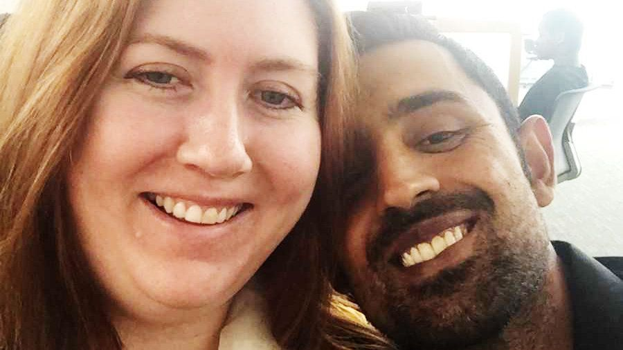 Jennifer Asif, left, and her husband Adnan Asif, right, pose for a selfie.