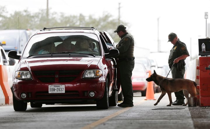 Border Patrol agents question drivers as they pass through the checkpoint at Falfurrias in south Texas in this file photo on