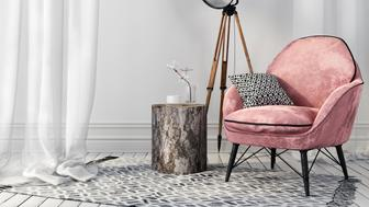 Air white interior with a stylish pink chair on metal legs and a vintage spotlight