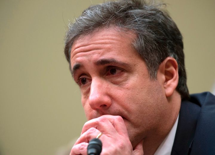 Michael Cohen, Donald Trump's former personal lawyer, tears up after testifying to the House Oversight Committee about the cr