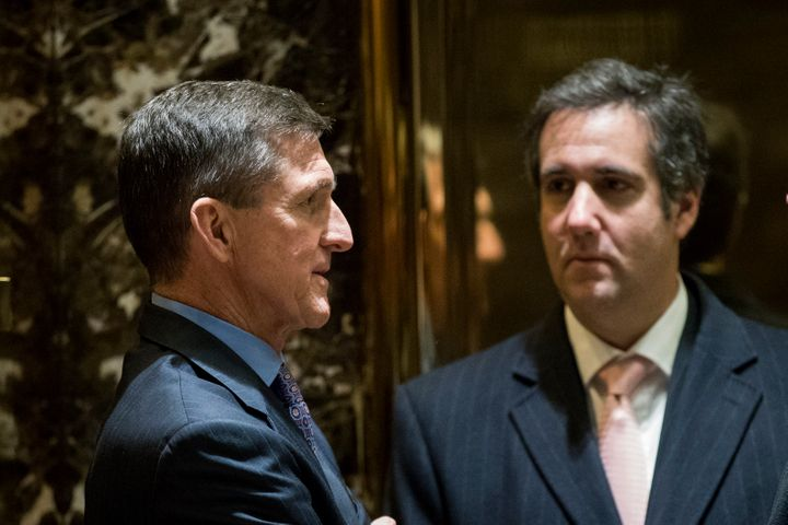 Michael Cohen, right, with former national security adviser Michael Flynn in the Trump Tower lobby after Trump's 2016 electio