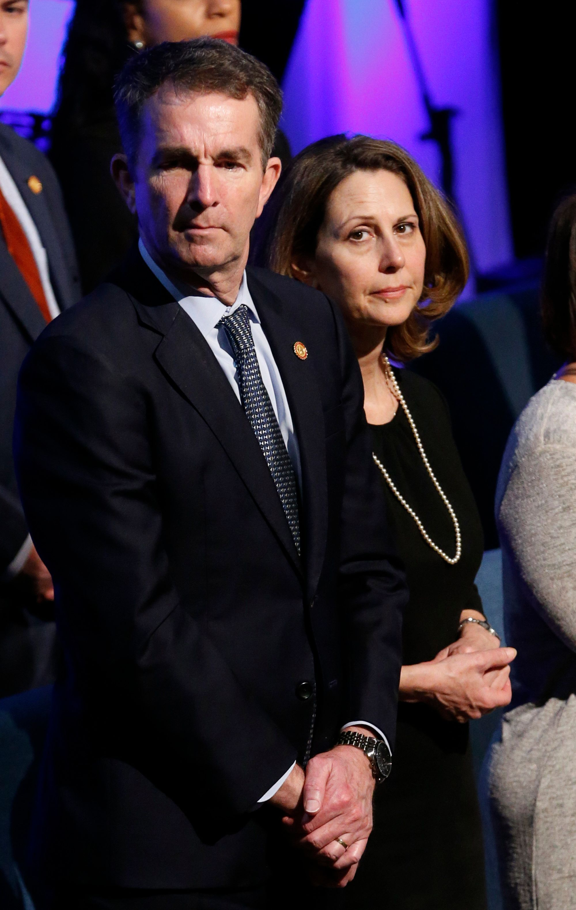 Virginia Gov. Ralph Northam, left, and his wife Pam, attend the funeral of Virginia State Trooper Lucas B. Dowell at the Chilhowie Christian Church in Chilhowie, Va., Saturday, Feb. 9, 2019. Dowell was killed in the line of duty earlier in the week. (AP Photo/Steve Helber, Pool)