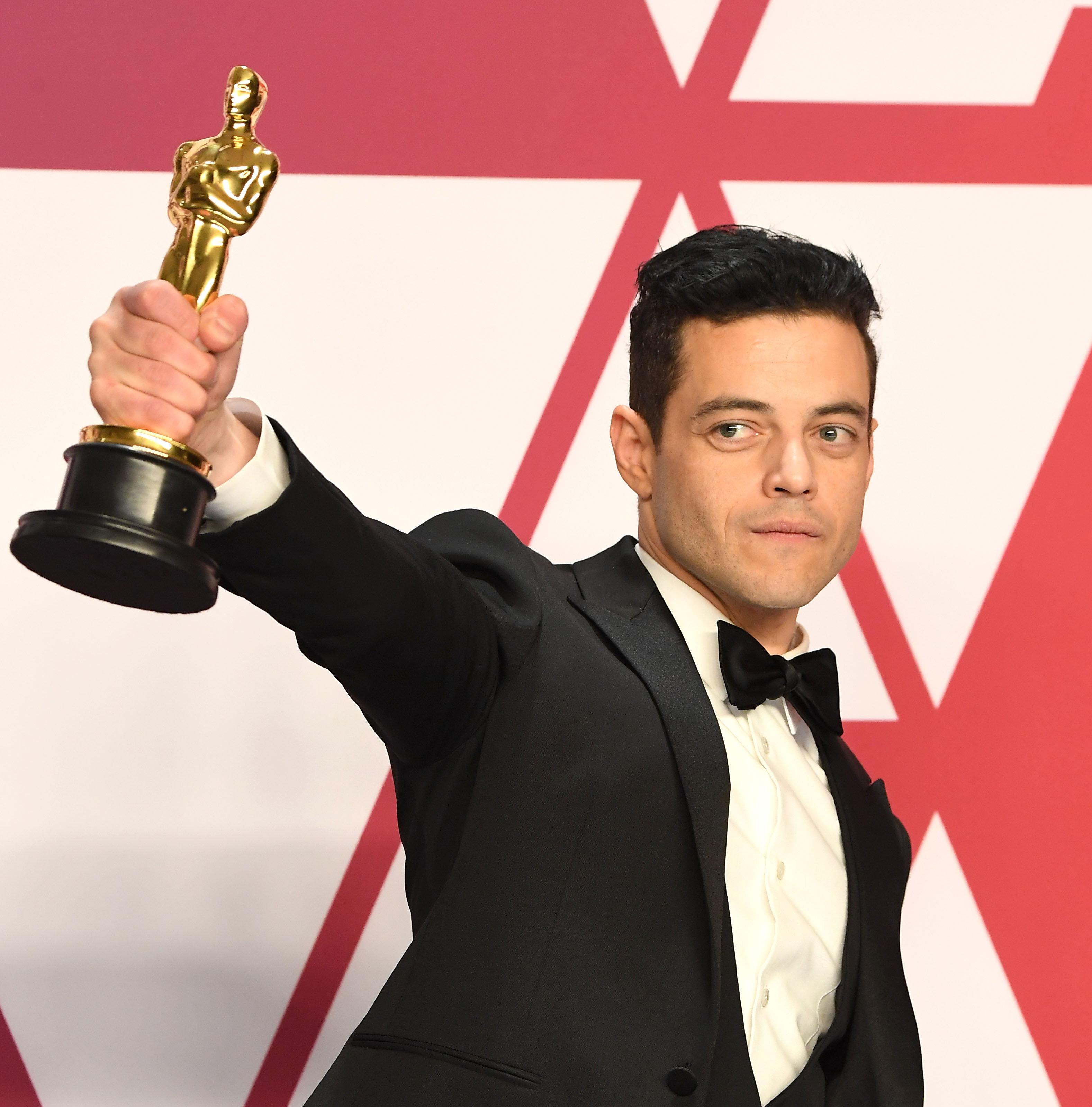 Rami Malek poses with his Oscar after the Academy Awards on Sunday.